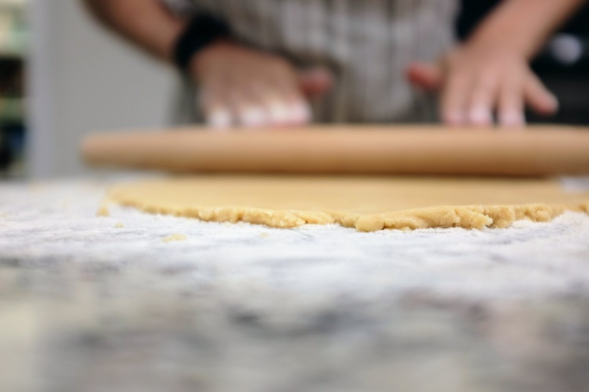 Rolling cookie dough with a rolling pin