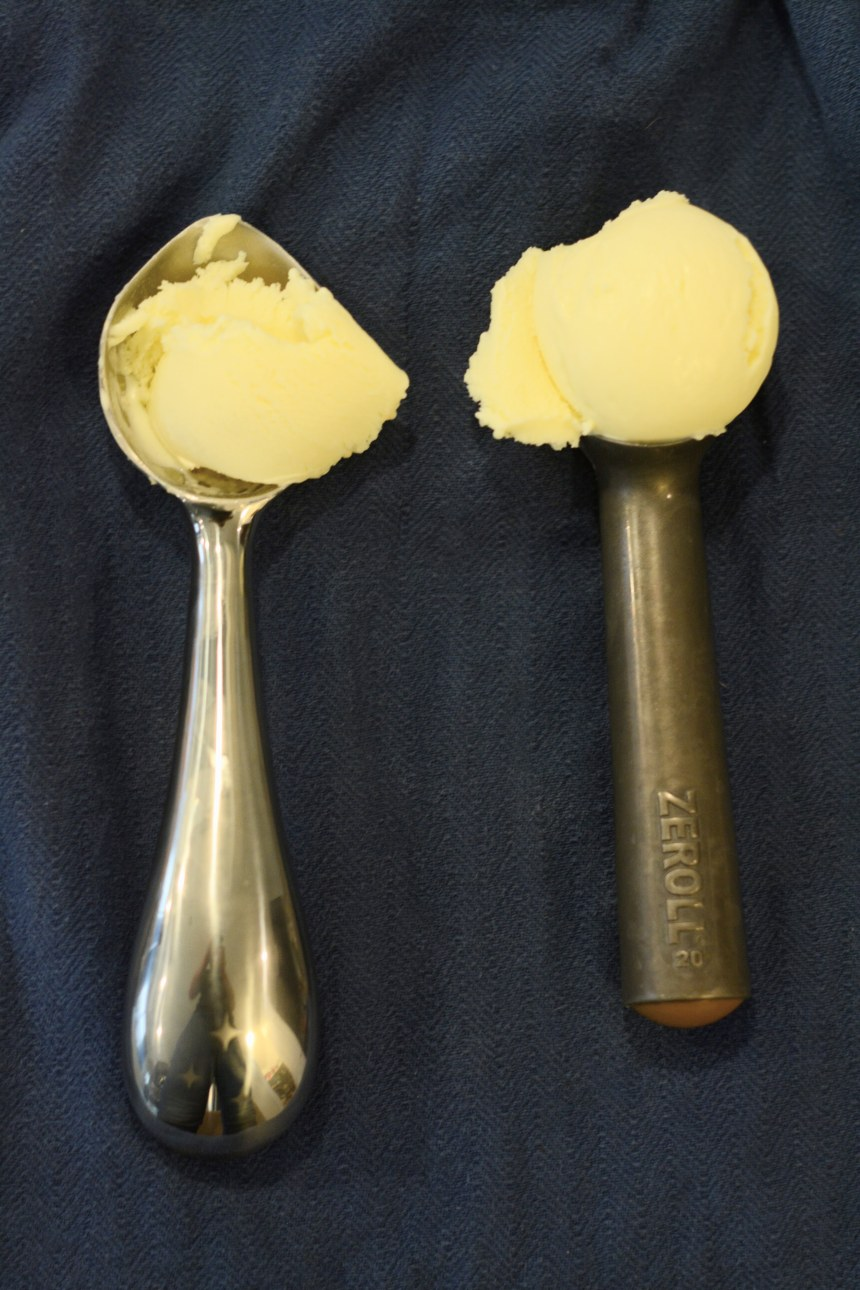 A side-by-side image of the Zeroll scoop with plain ice cream scooped in it, next to the Midnight Scoop with plain ice cream scooped in it. The Zeroll ice cream is the more ideal round shape.
